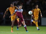 Newport County's Tristan Abrahams in action with West Ham United's Jack Wilshere on August 27, 2019