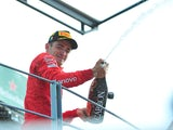 Charles Leclerc fizzes over the balcony after winning the Italian GP on September 8, 2019