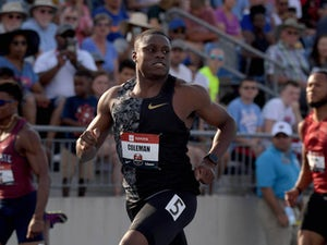 Coleman brushes off controversy after 100m triumph