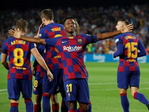 Barcelona's Anssumane Fati celebrates scoring their first goal with team mates on September 14, 2019