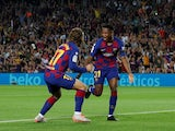 Barcelona's Anssumane Fati celebrates scoring their first goal with Antoine Griezmann on September 14, 2019