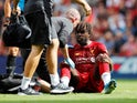 Divock Origi goes down injured during the Premier League game between Liverpool and Newcastle United on September 14, 2019