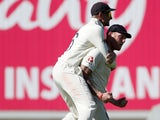 Joe Root mounts Ben Stokes after the wicket of Steve Smith falls on September 15, 2019