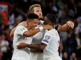 England's Jadon Sancho celebrates scoring their fourth goal with Harry Kane and Raheem Sterling on September 10, 2019