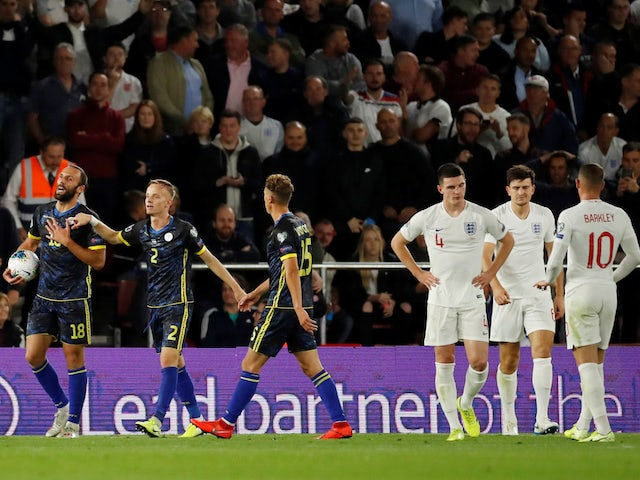 Kosovo's Vedat Muriqi reacts after being awarded a penalty due to being fouled by England's Harry Maguire on September 10, 2019