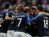 France's Wissam Ben Yedder celebrates scoring their third goal with Antoine Griezmann and team mates on September 10, 2019