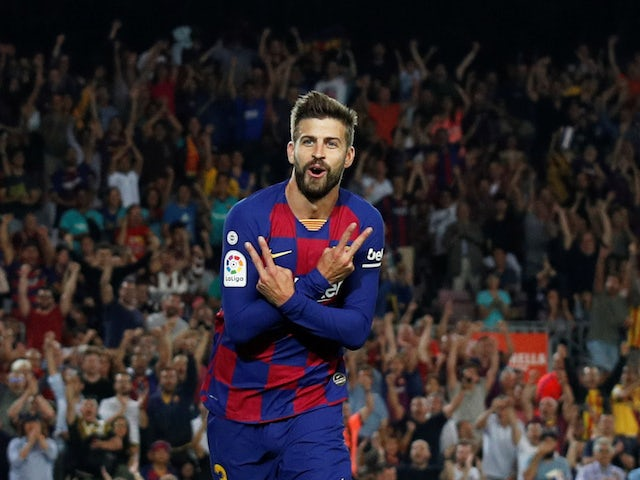 Barcelona's Gerard Pique celebrates scoring their third goal against Valencia on September 14, 2019