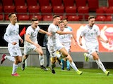 Ireland's Conor Masterson (R) celebrates with teammates after a goal on September 10, 2019