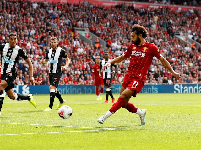 Mohamed Salah scores the third during the Premier League game between Liverpool and Newcastle United on September 14, 2019