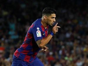 Barcelona's Luis Suarez celebrates scoring their fourth goal against Valencia on September 14, 2019