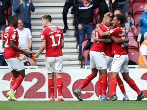 Middlesbrough hang on to edge past Reading