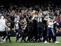 New Orleans Saints players mob kicker Wil Lutz (3) following a 58 yard game winning kick against the Houston Texans at the Mercedes-Benz Superdome on September 10, 2019