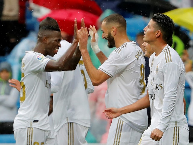 Real Madrid players celebrate Karim Benzema's second goal against Levante in La Liga on September 14, 2019