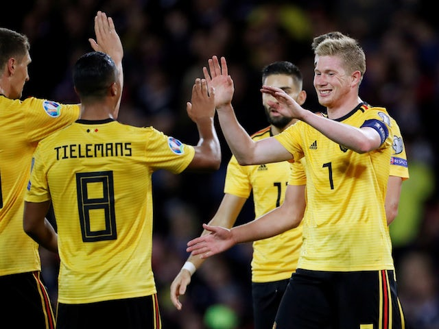 Belgium's Kevin De Bruyne celebrates scoring their fourth goal with Youri Tielemans and team mates on September 9, 2019