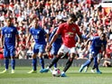 Manchester United's Marcus Rashford scores from the penalty spot against Leicester City on September 14, 2019