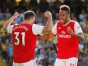 Pierre-Emerick Aubameyang celebrates with Sead Kolasinac after scoring during the Premier League game between Watford and Arsenal on September 15, 2019