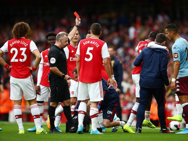 Arsenal's Ainsley Maitland-Niles is shown a red card by referee Jonathan Moss on September 22, 2019