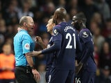 West Ham United's Mark Noble and Angelo Ogbonna protest as teammate Arthur Masuaku is sent off by referee Mike Dean on September 16, 2019