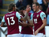 Chris Wood celebrates scoring his second for Burnley with Jeff Hendrick on September 21, 2019
