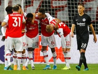 Arsenal's Joe Willock celebrates scoring their first goal with Pierre-Emerick Aubameyang and team mates as Eintracht Frankfurt's Dominik Kohr looks dejected on September 19, 2019