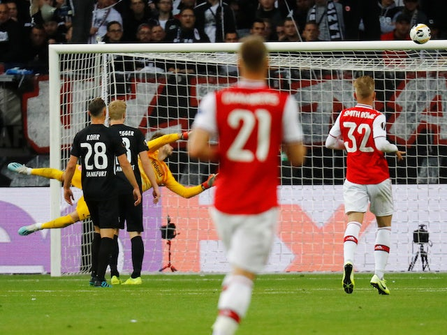 Arsenal's Joe Willock scores their first goal past Eintracht Frankfurt's Kevin Trapp on September 19, 2019