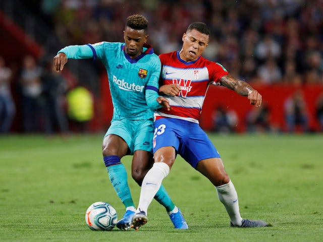 Barcelona's Nelson Semedo in action with Granada's Darwin Machis in La Liga on September 21, 2019