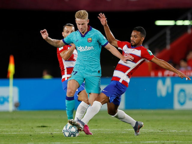 Barcelona's Frenkie de Jong in action with Granada's Yangel Herrera in La Liga on September 21, 2019