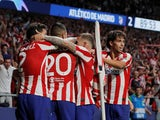 Atletico Madrid's Hector Herrera celebrates scoring their second goal with teammates against Juventus on September 18, 2019