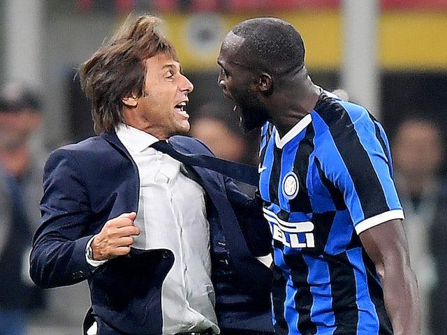 Inter Milan's Romelu Lukaku celebrates scoring their second goal with coach Antonio Conte against AC Milan on September 21, 2019