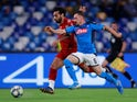 Liverpool's Mohamed Salah in action with Napoli's Mario Rui on September 17, 2019