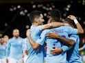 Manchester City's Ilkay Gundogan celebrates scoring their second goal with Riyad Mahrez and Raheem Sterling on September 18, 2019