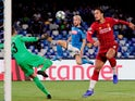 Napoli's Dries Mertens in action with Liverpool's Virgil van Dijk and Adrian on September 17, 2019