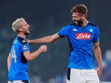 Napoli's Fernando Llorente and Dries Mertens celebrate after the match on September 17, 2019