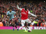 Arsenal's Nicolas Pepe scores their first goal from the penalty spot against Aston Villa on September 22, 2019
