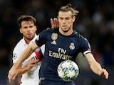 Real Madrid's Gareth Bale battles Paris Saint-Germain's Juan Bernat during their Champions League clash on September 18, 2019