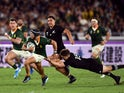 South Africa's Cheslin Kolbe in action with New Zealand's Beauden Barrett on September 21, 2019