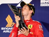 Ferrari's Sebastian Vettel kisses the trophy as he celebrates after winning the race in Singapore on September 22, 2019