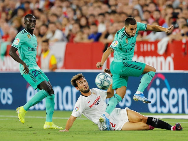 Real Madrid's Eden Hazard in action with Sevilla's Franco Vazquez in La Liga on September 22, 2019