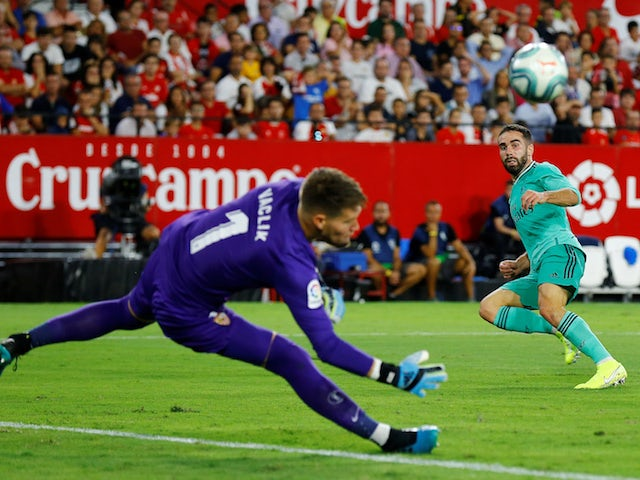 Real Madrid's Dani Carvajal tests Sevilla's Tomas Vaclik during their La Liga clash on September 22, 2019