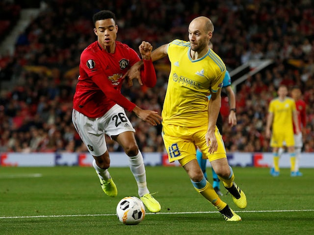Manchester United's Mason Greenwood in action with Astana's Ivan Maevski in the Europa League on September 19, 2019