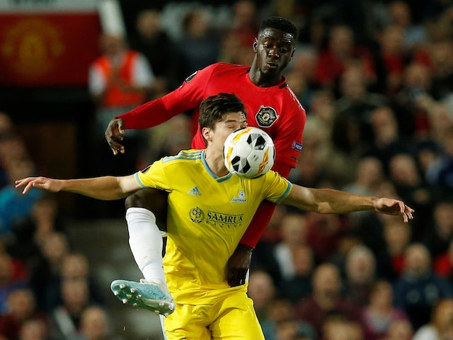 Manchester United's Axel Tuanzebe in action with Astana's Dorin Rotariu in the Europa League on September 19, 2019