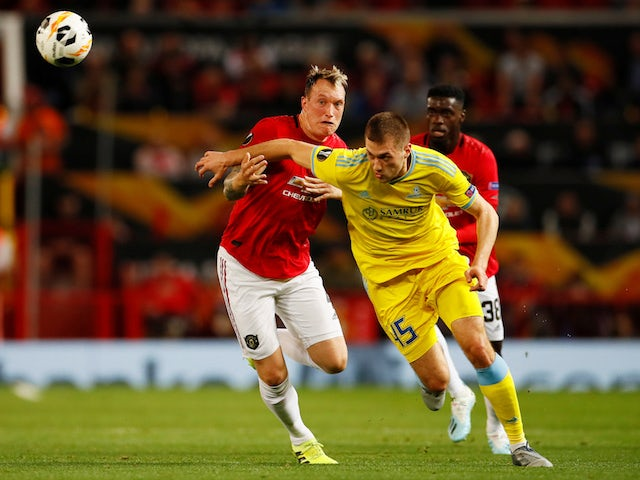 Manchester United's Phil Jones in action with Astana's Roman Murtazayev in the Europa League on September 19, 2019