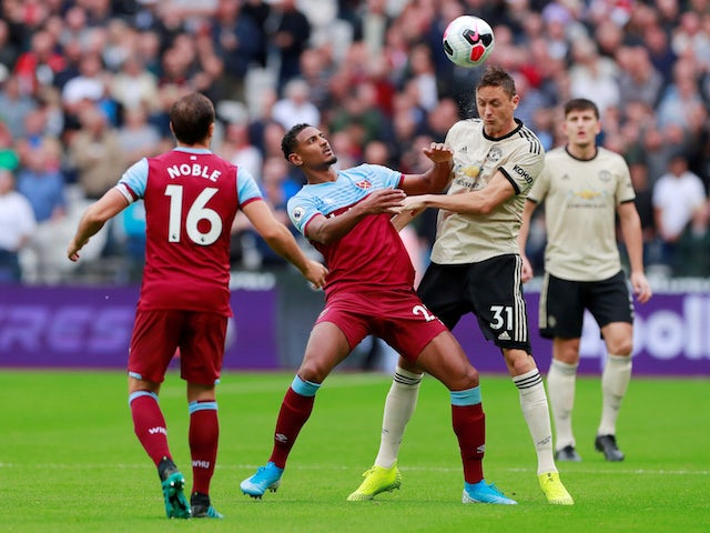Manchester United's Nemanja Matic in action with West Ham United's Sebastian Haller in the Premier League on September 22, 2019