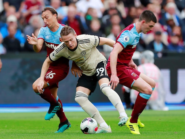 Manchester United's Scott McTominay in action with West Ham United's Declan Rice in the Premier League on September 22, 2019