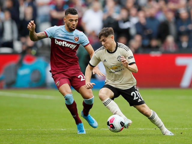 Manchester United's Daniel James in action with West Ham United's Ryan Fredericks in the Premier League on September 22, 2019