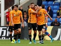 Wolverhampton Wanderers' Diogo Jota celebrates scoring their first goal with Patrick Cutrone and team mates on September 22, 2019