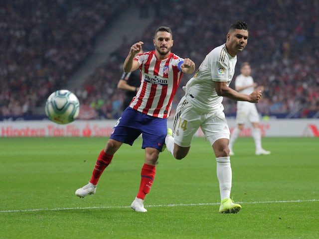 Real Madrid's Casemiro in action with Atletico Madrid's Koke in La Liga on September 28, 2019