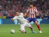 Real Madrid's Eden Hazard in action with Atletico Madrid's Joao Felix in La Liga on September 28, 2019