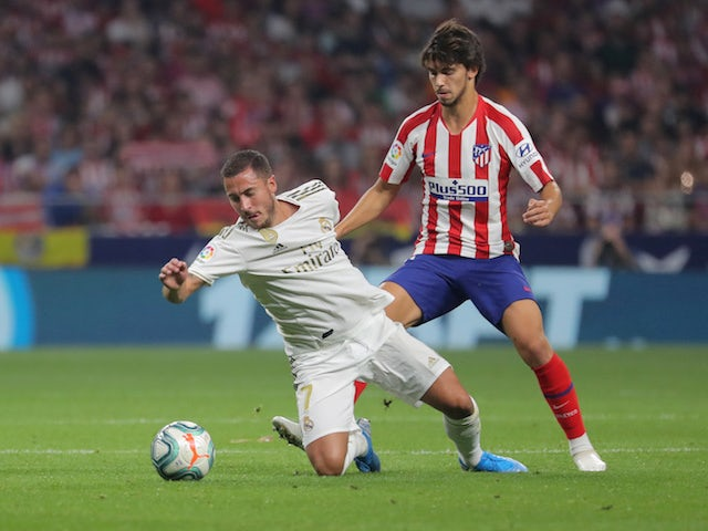 Real Madrid's Eden Hazard in action with Atletico Madrid's Joao Felix in La Liga on September 28, 2019