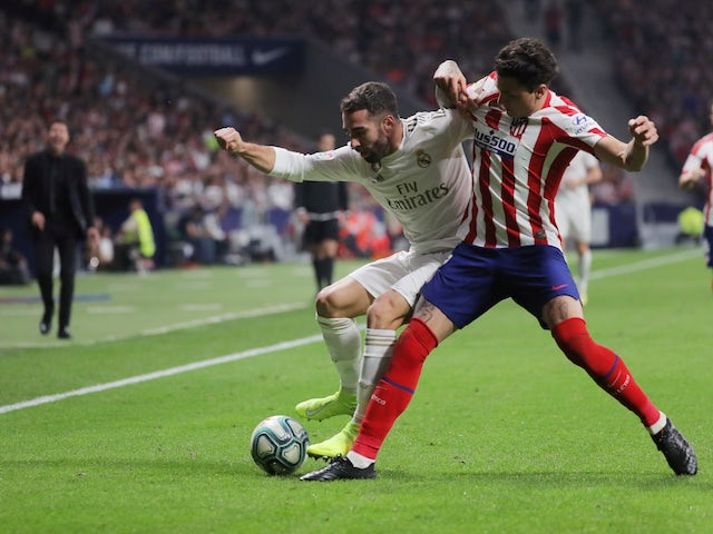 Real Madrid's Dani Carvajal in action with Atletico Madrid's Jose Gimenez in La Liga on September 28, 2019